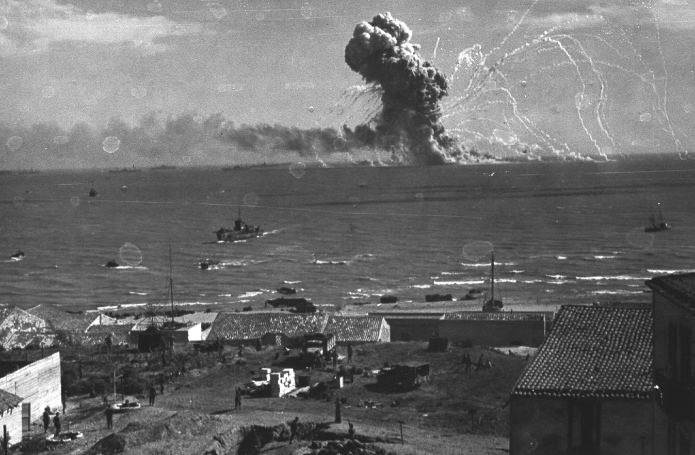 An exploding ship by the beach of Sicily, 1943